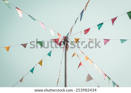 colorful festive bunting flags against, vintage style. - stock photo
