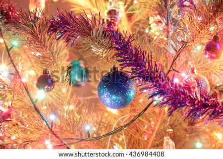 colorful festive Christmas tree ornaments and garland