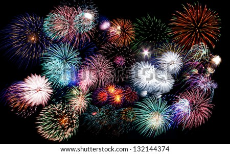 Colorful festive fireworks  sparklers  salute and petards explosions isolated over black night sky background - stock photo