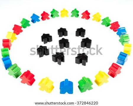 colorful figures surround black figures on white - stock photo