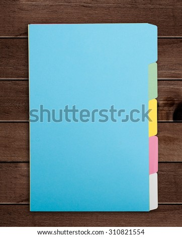 Colorful File Folders on wooden background.