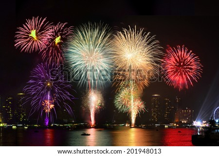 Colorful firework display on the river
