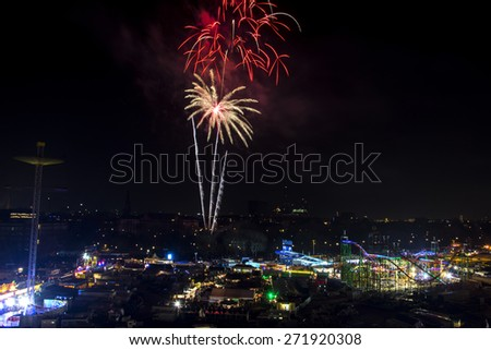 Colorful Firework over Hamburg, Germany and the amusement park