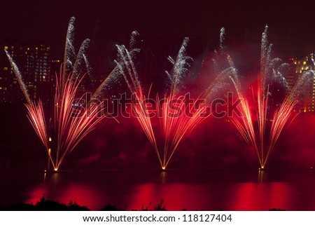 colorful firework show finale with multiple bursts - stock photo