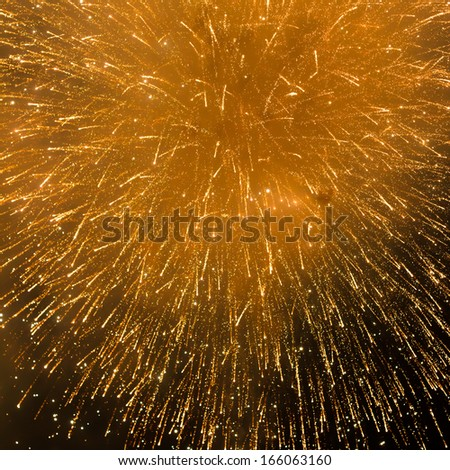 colorful fireworks against night background for new year celebration - stock photo