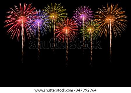 Colorful fireworks celebration on dark background. - stock photo
