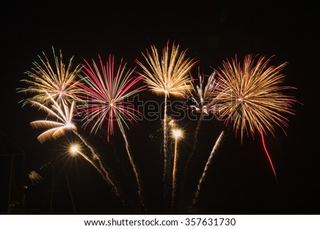 Colorful Fireworks Display.  Bright colored fireworks finale. - stock photo
