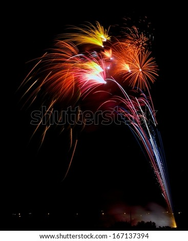 Colorful fireworks explosion in dark sky background, 4 of July, Independence day, explode, fireworks festival fragment close up with trees silhouette in background in Malta,Malta fireworks festival - stock photo