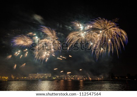 Colorful fireworks night, rainbow Salute in different colors - stock photo