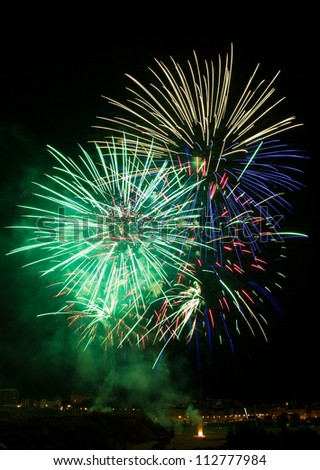 Colorful fireworks of various colors. - stock photo