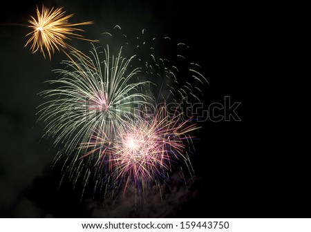 Colorful fireworks of various colors over night sky  - stock photo