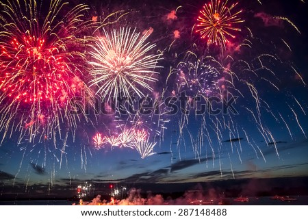 colorful fireworks on the black sky background over-water - stock photo