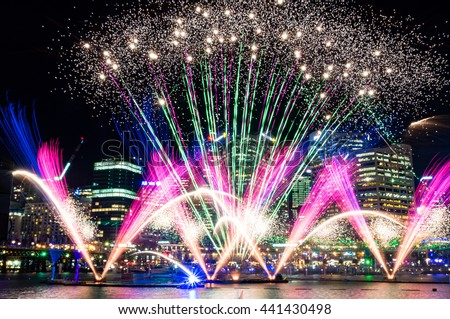 Colorful fireworks on the water at Darling Harbour as part of annual lighting festival Vivid Sydney: Festival of Light, Music and Ideas - stock photo