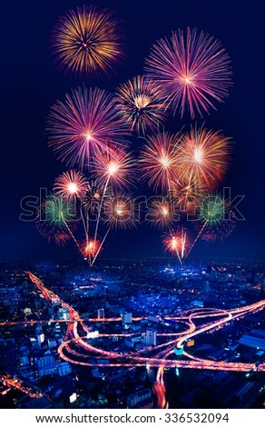 colorful fireworks on topview city scape of bangkok, thailand - stock photo