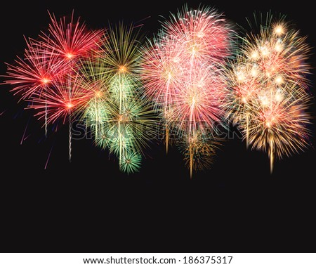 Colorful fireworks over black screen background