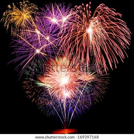 colorful fireworks over dark sky background - stock photo
