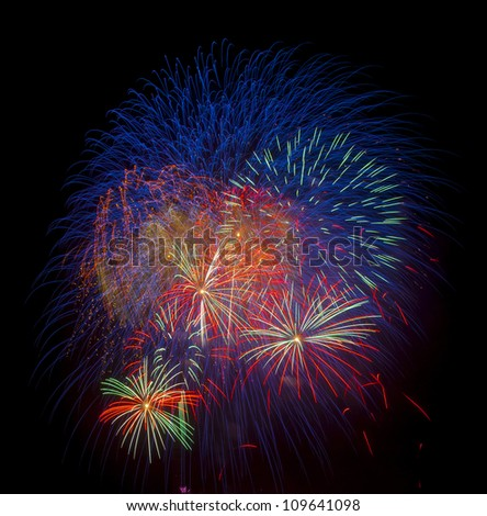 Colorful fireworks  over night sky - stock photo
