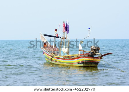 colorful fisherman boat in the sea,select focus with shallow depth of field.