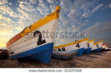 Colorful fishing boats at the beach of Senga Bay, Lake Malawi, Malawi - stock photo