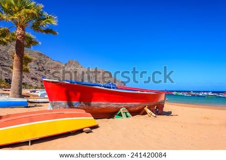 Colorful fishing boats on beach Playa de las Teresitas, Tenerife island, Spain - stock photo