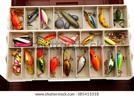 Colorful fishing lures in an old tackle box. - stock photo