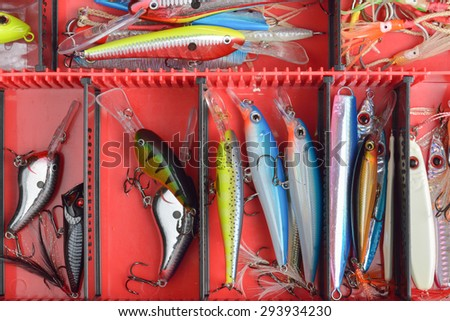 Colorful Fishing Lures on plastic box  desk different fishing baits The fishing equipment. - stock photo