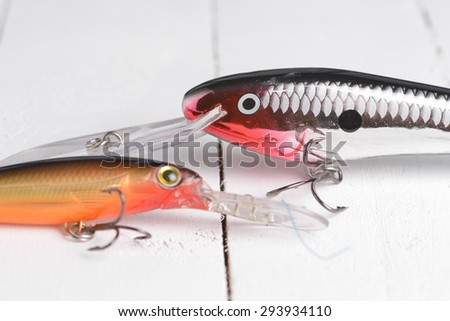 Colorful Fishing Lures on wood desk - stock photo