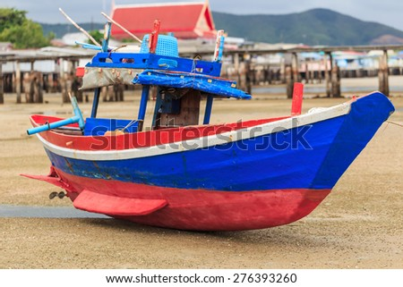 colorful fishing wood boat sitting on the beach