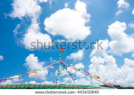 colorful flag on boat  against blue sky with cloud  - stock photo