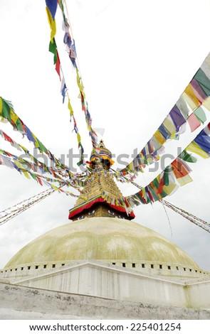 Colorful flags and dome of Swayambhunath Stupa, Kathmandu, Nepal - stock photo