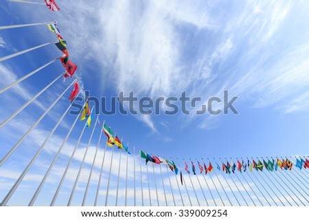 colorful flags in blue sky with clouds, skyline, landscape