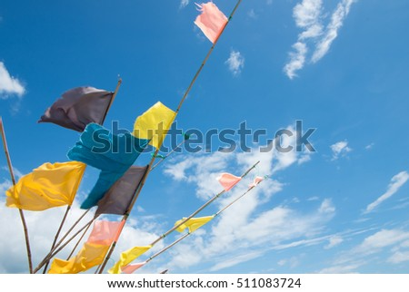 Colorful flags on the blue sky