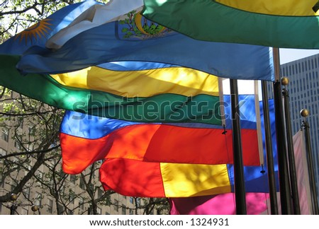 Colorful flags wave in the wind - stock photo