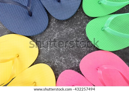 colorful flip flops in a circle summer concept - stock photo