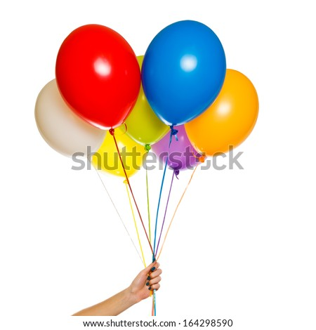 Colorful floating balloons isolated on white background. Woman hand holding Celebration or Birthday party balloons - stock photo