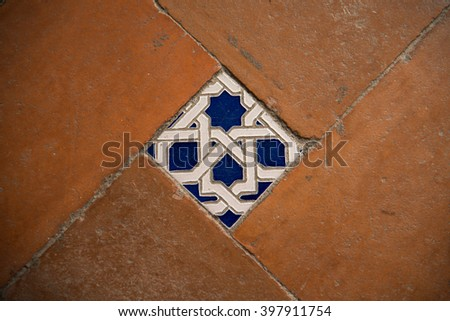 Colorful floor tiles of the Monastery of Saint John of the Kings Toledo - stock photo