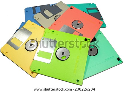 Colorful floppy disks on white background - stock photo