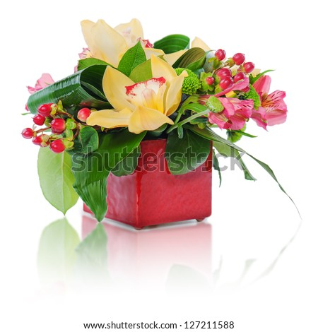 colorful floral bouquet of roses, cloves and orchids arrangement centerpiece in vase isolated on white background - stock photo