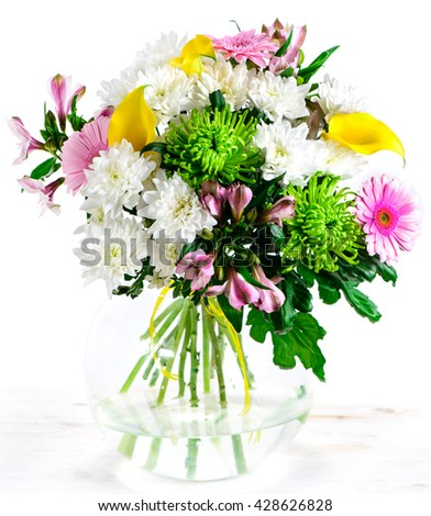 Colorful flower bouquet arrangement centerpiece in vase isolated
