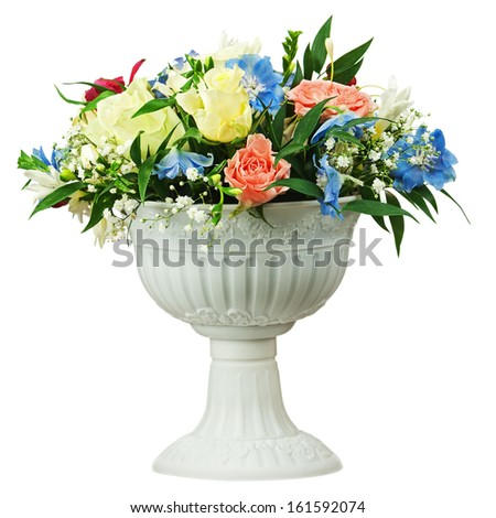 Colorful flower bouquet arrangement centerpiece in vase isolated on white background. Closeup. - stock photo