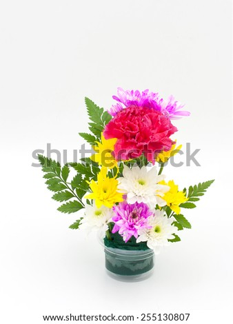 Colorful flower bouquet arrangement in vase on white background