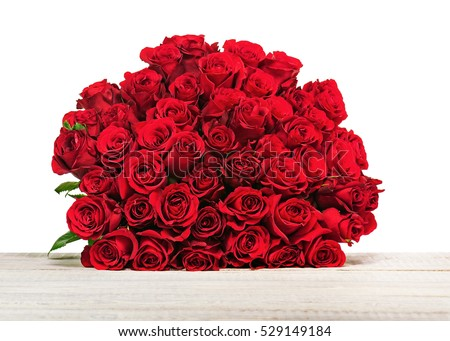 Colorful flower bouquet from red roses isolated on wooden background. Closeup