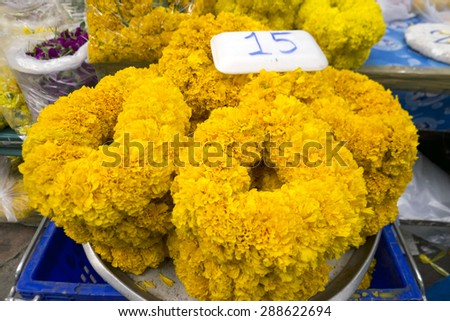 colorful flower offers at the flower market in Bangkok - stock photo