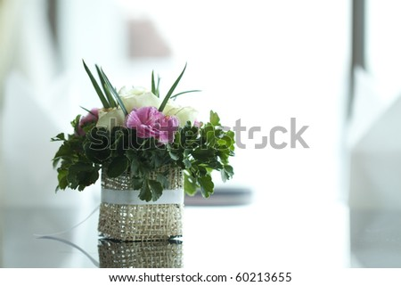 Colorful flower on table - stock photo