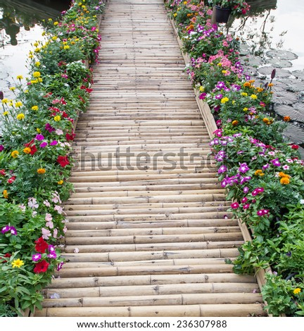 colorful flower  with bamboo bridge entrance - stock photo