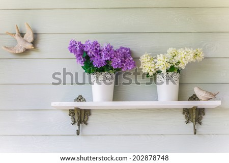 colorful flowers in pots vintage on wall - stock photo