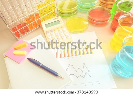 Colorful fluid in glass ware and graph for laboratory  with vintage color style