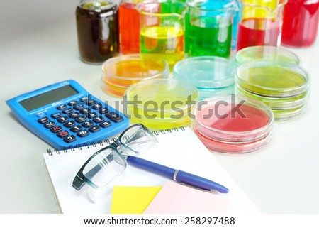 Colorful fluid in petridish for laboratory use on table in laboratory  - stock photo