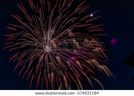 Colorful Fourth of July fireworks against night sky