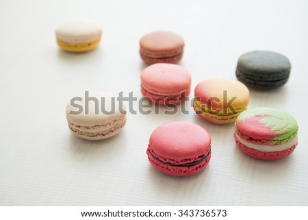 Colorful france macarons on white wood background -  selective focus